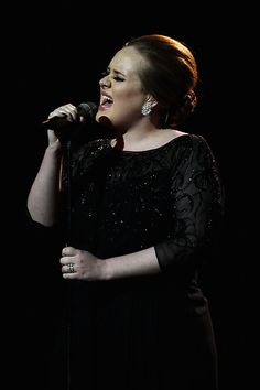Adele. I want to BE her... Or just sing like her... and maybe be British.