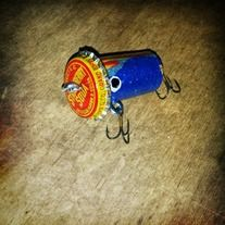This is a handmade wine cork/bottle cap crank bait lure. Hand painted. Custom colors available upon request.
