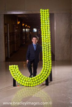 For this Bar Mitzvah celebration, the Bar Mitzvah boy and his grandfather created a clever sign-in board using tennis balls!