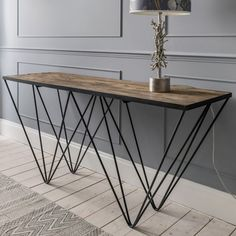 Ruffin Console Table - Graham & Green. I love the industrial look of this table but I'm not sure if the materials (iron, elm & plywood) can be considered sustainable. It's not mentioned if they are reclaimed.