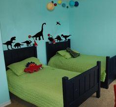 little dinosaurs walking around on bedroom furniture