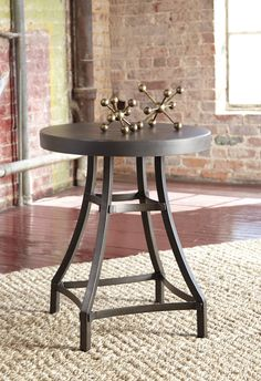 Starmore Round End Table - For fans of urban industrial design, the Starmore round end table clearly steals the show. Incorporation of sleek, tubular metal adds a modern element, while the tabletop—crafted with composite cement—tops off the look in an ultra-cool way.