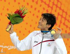 Ryosuke Irie of Japan celebrates on the podium at the medal ceremony for the Swimming Men's 200m Backstroke during day three of the Guangzhou Asian Games at Guangzhou Aoti Aquatics Centreon November 15, 2010 in Guangzhou, China.