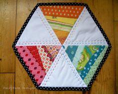 Twirly hexagon mug rug photo by Sarah @ FairyFace Designs, via Flickr