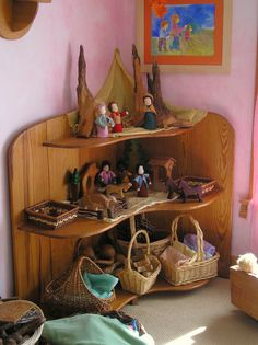 Gorgeous, grounded play area.  Just right.  Everything in its place and a place for everything.  And notice how they are 'put away' in a way that invites play.  So different than a toy box full of stuff.  This shelf is a story waiting to be played.  -Angelina soul-centered-parenting.com