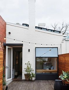 A beautiful Melbourne terrace renovation with a sustainable outlook - In summer, the rooftop garden comes into its own. In the morning it's used for sitting in the sun - Indoor Outdoor, Outdoor Areas, Outdoor Decor, Terrace Design, Garden Landscape Design, Melbourne, Piazza San Marco, Contemporary Beach House, Outdoor Cinema