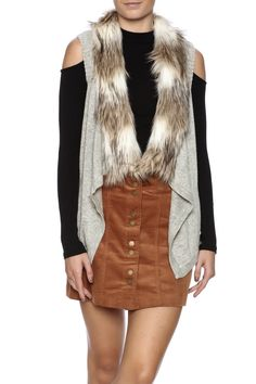 Sleeveless knit vest with faux fur collar.   Faux Fur Knit Vest by Bio. Clothing - Jackets, Coats & Blazers - Vests Manhattan, New York City Naples, Florida