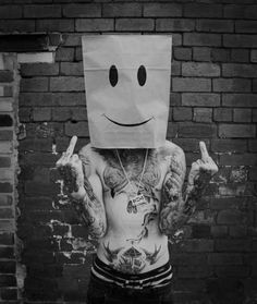 Fuck you. Tattoos. Paper bag. Smile. I love it! LOL