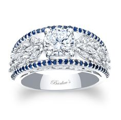 Blue Sapphire Engagement Ring - 7980LBSW - This unique modern white gold diamond engagement ring/diamond wedding band features a round prong set diamond center embellished on the shoulders with a spray of marquise cut diamonds artfully cascading down the sides. A ridge of shared prong set blue sapphires frame the artful shoulders for an elegant touch of glamour.    Also available in rose, yellow gold, 18K and Platinum,