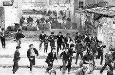A skirmish between Irish youth fighting with stones and British paratroopers