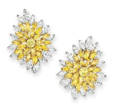 A PAIR OF COLORED DIAMOND AND DIAMOND EAR CLIPS, BY VAN CLEEF & ARPELS   Each designed as a circular and marquise-cut yellow diamond cluster, trimmed with marquise-cut diamonds, mounted in gold and platinum, with pendant hooks for suspension, circa 1973  Signed V.C.A. for Van Cleef & Arpels, N.Y., no. 43802