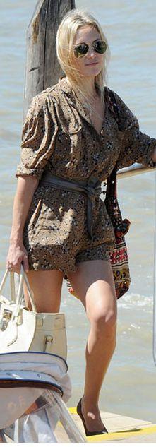 Who made Kate Hudson's aviator sunglasses, handbag, print romper, and print handbag that she wore in Venice? Sunglasses – Ray Ban  Romper – Twenty8Twelve  Purse – Simone Camille  Purse – Roberto Cavalli