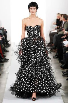 Black and white spotted evening gown from Oscar de la Renta's Fall 2014 Collection.   Can we sell designer fashions from the Noosa House... ??