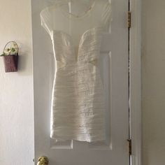White Creme Sheer Dress A white Creme color, has a deep plunge neck line, sheer, short can fit s/m size. Only worn once! Agaci Dresses