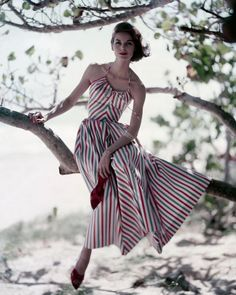 Anne St. Marie in a halter top satin striped dress by Hope Skillman, photo by Roger Prigent for Vogue, May 1957.