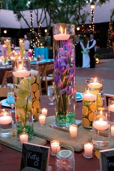 candles centerpieces and flower arrangements for summer decorating