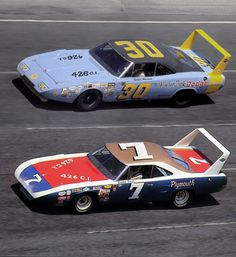 Vintage Race Cars  1969 Dodge Charger Daytona on the top and 1970 Plymouth Road Runner Superbird on the bottom.