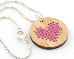 Here's a sweet little heart necklace to cross stitch yourself. Made from eco-friendly bamboo, the pendant comes with precision-cut holes that are a breeze to stitch into. It's project that's easy enough for beginners and fun for even the most advanced stitchers. Each pendant measures 1 inch in diameter and is 2.7mm thick. The kit comes with everything you need to make one pendant, including: