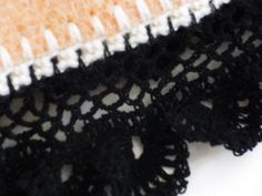 detail woonkleed van een oude deken