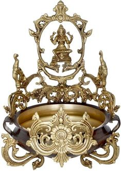 The urli is a characteristic feature of traditional Indian homes, the likes of which are hardly to be found in cultures beyond Southeast Asia. It is a simple shallow-bottomed vessel with a wide rim. Hindu Statues, Money Pictures, Brass Statues, Indian Homes, India Art, Picture Wall, Feng Shui, Exotic, Sculptures
