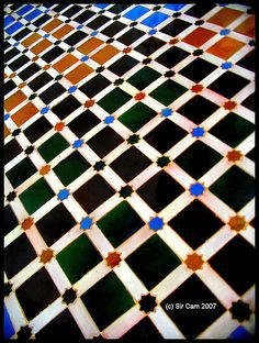 Detail of Islamic tilework from the  Patio de los Arrayanes, Alhambra, Granada, Spain