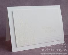white embossing on white paper
