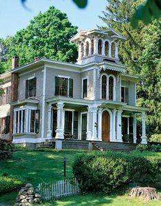 Victorian Italianate mansion. It is big, but the porch and yard are beautiful. I love houses in this style.