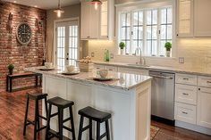 kitchen cabinets islands the wood beams and the brick columns rustic wood 3043