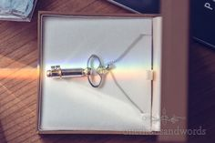 Illuminated key necklace on morning of Bournemouth Hotel Wedding. Photography by one thousand words wedding photographers