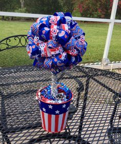3 rolls of ribbon cut in 3 inch strips. Pinned with straight pins. Took me about an hour to make. I'm well pleased. Patriotic Crafts, Patriotic Decorations, July Crafts, Summer Crafts, Diy And Crafts, Ribbon Projects, Craft Projects, Ribbon Topiary, Let Freedom Ring