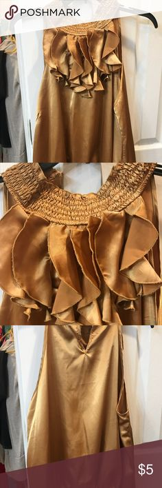 Beautiful gold halter top Dress it up or down this is a beautiful gold halter style blouse. Ruffle neck detail and elastic waist. Tops Blouses