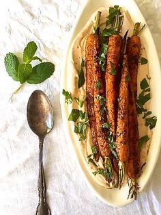 Roasted carrots with harissa yogurt and mint