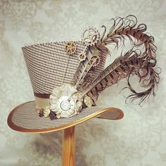 Brown tweed mini top hat, percher hat, decorated with cogs and gears and pheasant feathers. Steampunk Top Hat, Steampunk Cosplay, Steampunk Fashion, Steampunk Clothing, Steampunk Necklace, Steampunk Female, Gothic Steampunk, Pheasant Feathers, Peacock Feathers