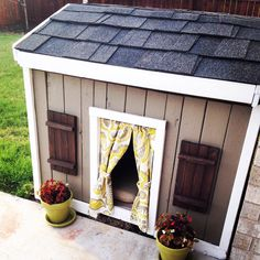 DIY doghouse from construction scraps... It's amazing what a little paint & stain can do :)