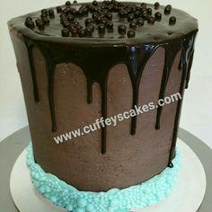 Chocolate cake, ganache, mocha mousse, swiss meringue outside, mocha ganache drip, Valhrona° pearls