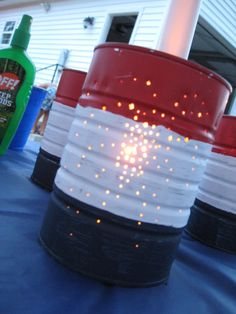 Easy  Inexpensive can luminaries for any patriotic event or backyard bbq. Recycle canned food tins for a candle holder (use citronella candles)