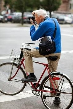 Old man + camera + red bicycle kconroy