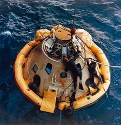 Navy frogmen recover the Apollo 6 command module, 375 nautical miles north of Honolulu, Hawaii, 4 April 1968.