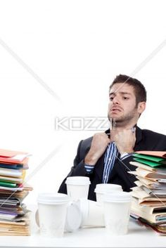 exhausted businessman with coffee glass and files on his desk. - Image of a exhausted businessman with coffee glass and files on his desk against white background, Model: Adam Mirani