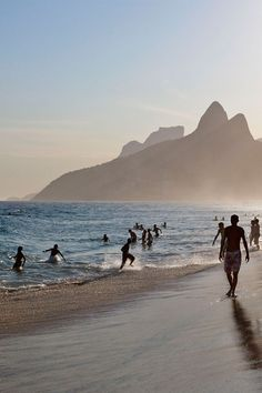 A late afternoon stroll along Rio's famed Ipanema Beach. Cariocas (Rio residents) make the most of their geographically blessed city // photo by Michael Heffernan in our December '13 issue #rio #brazil #beach #sea #sun