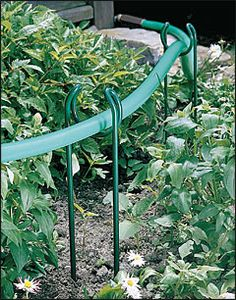 Simpledefinitely trying this Door Knob Garden Hose Guide On