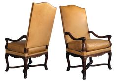 a boldly-scaled pair of french regence style carved walnut fauteuils a la reine