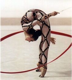 rhythmic gymnastics   Love the costume as well as the performance.