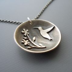 Silver Hummingbird Necklace - Flower Motif - Nature Jewelry by lisahopkins on Etsy https://www.etsy.com/listing/79357251/silver-hummingbird-necklace-flower-motif