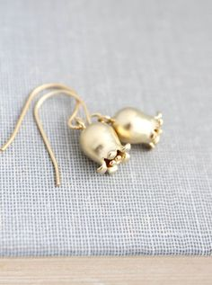 These are little gold bell flower earrings! These earrings are inspired by Spring bell flowers including lily of the valley and tulips. These