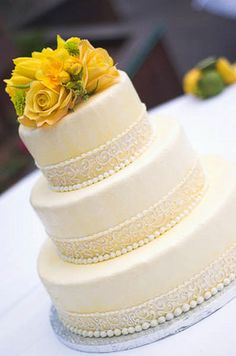 Wedding Cake with Icing Pearls and Swirl Design (with different flowers)