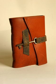 Red Leather Journal with Handmade Paper by Binding Bee in Indianapolis, Indiana. $68.00, via Etsy. Key attached to strap, key tucks into cover sewn strap. Clever!