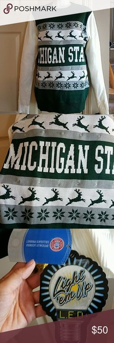 """Michigan State LED Christmas Sweater S Michigan State LED Christmas Sweater Small. New with tags, battery mechanism still has plastic inserted so sweater is untested.   100% acrylic.  Officially licensed collegiate product.  Chest laying flat 20"""" Sleeve length 29.5"""" Shoulder to bottom hem 29""""  Smoke free home. Light 'em Up Sweaters Crew & Scoop Necks"""