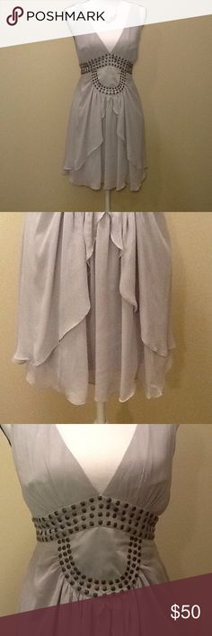 BCNGenerations Dress NWT Size 6 Light Gray Stunning dress by BCBGeneration, NWT, size 6, beautiful light gray,silver color with antique gold accents.  Very Stylish, unique design, fully lined, back zipper for easy pull on, retails for $128. Also included is the necklace shown which is adjustable with beautiful jewels in light purple, mother of pearl and a light gold with a gold chain' $15 retail, new without tags. Dress measures approx 31 in long, waist 28.  Perfect for a night on the town…