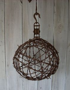Look!! My dad's barbed wire ball made it onto someone's pinterest board! We saw it when we were searching today!